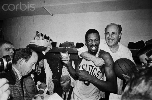 Red Auerbach Hugging Bill Russell at Press Conference